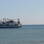 ¿Por qué se emplea corriente contínua en sistemas submarinos de larga longitud?