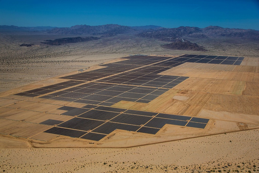 "Solar panels are seen in this aerial photograph of First Solar Inc.'s Desert Sunlight Solar Farm in Mojave Desert, California, U.S., on Friday, April 5, 2013. First Solar Inc., the largest thin-film panel manufacturer, sees ""significant growth"" in renewable energy projects being developed in the Middle East and North Africa by the end of 2014. Photographer: Tim Rue/Bloomberg"